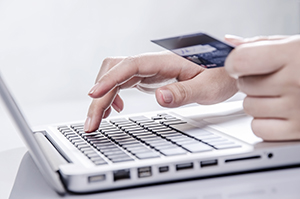 Shopping online with credit card on laptop